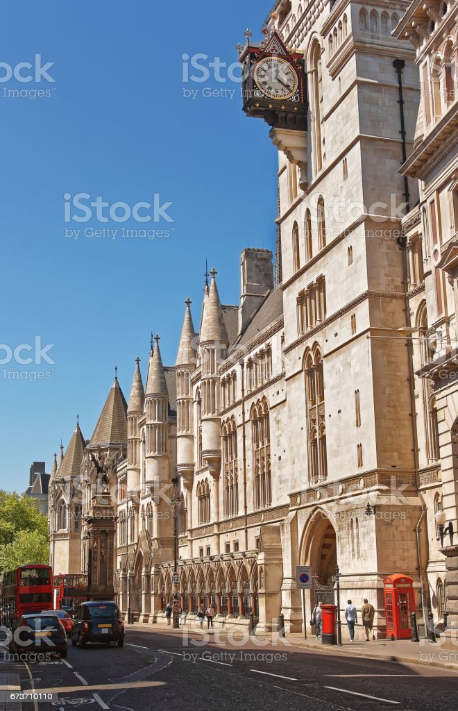 Clock on the Royal Courts of Justice in London stock photo