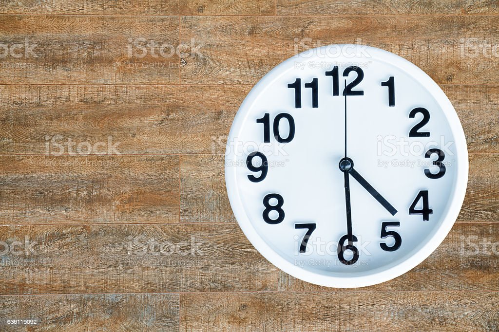 Clock on wood background stock photo