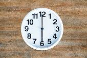 Clock on wood background