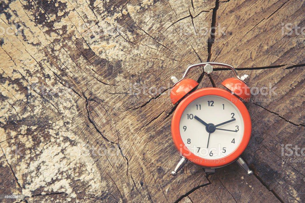 Clock on wood stock photo