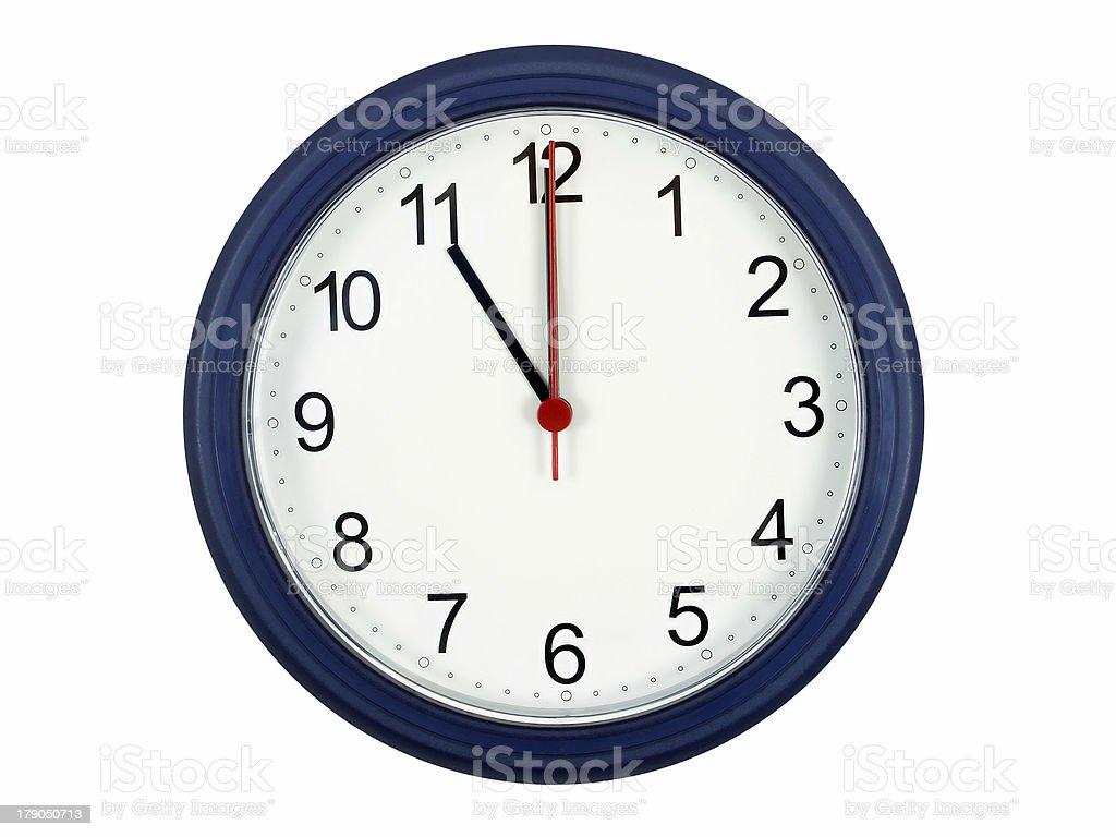 Clock showing 11 o'clock royalty-free stock photo