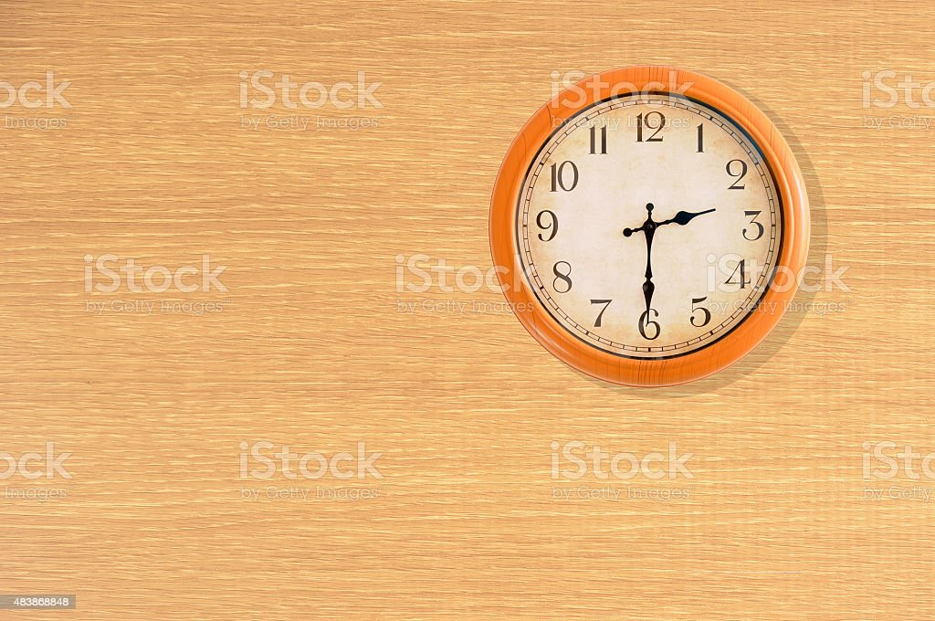 Clock showing 2:30 o'clock on a wooden wall stock photo