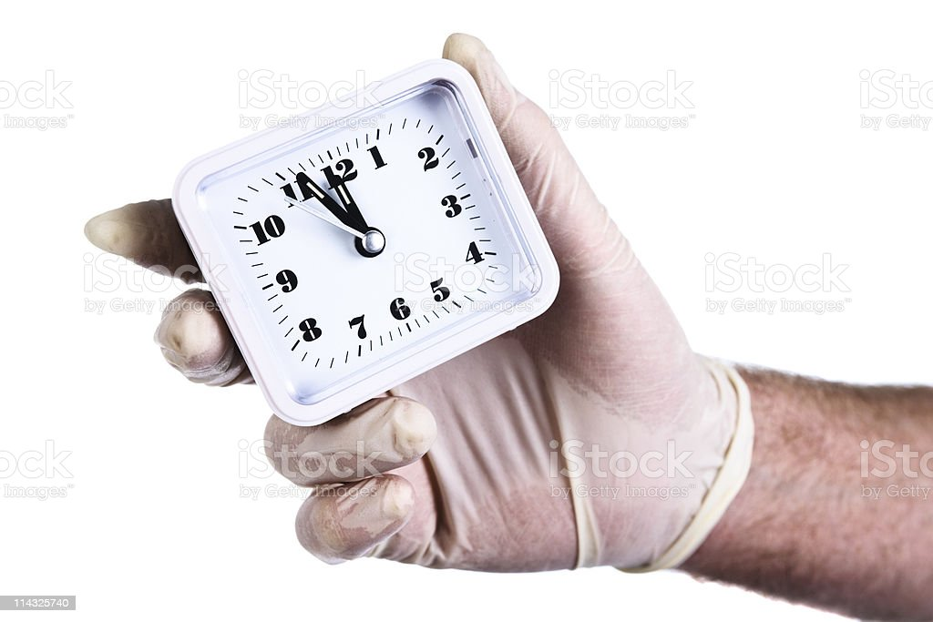 Clock  showing 23h59 held in single gloved hand stock photo