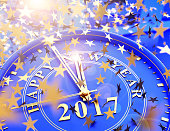 clock showing last Minutes to 2017 and falling stars confetti