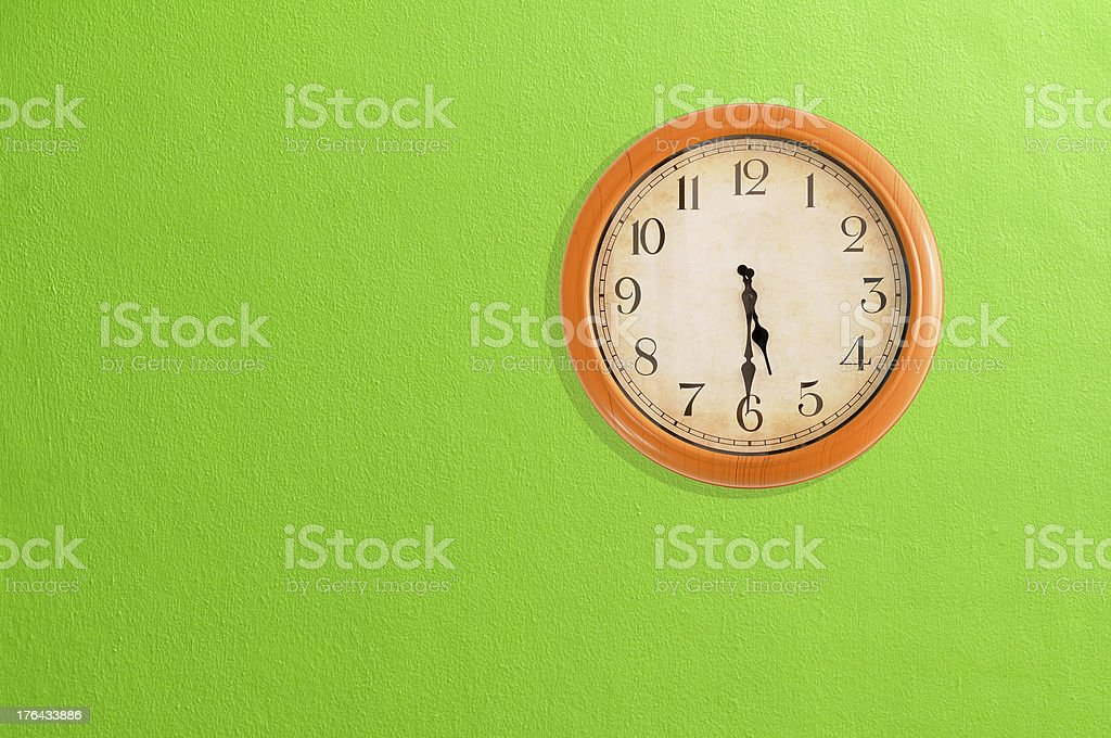 Clock showing on a green wall stock photo