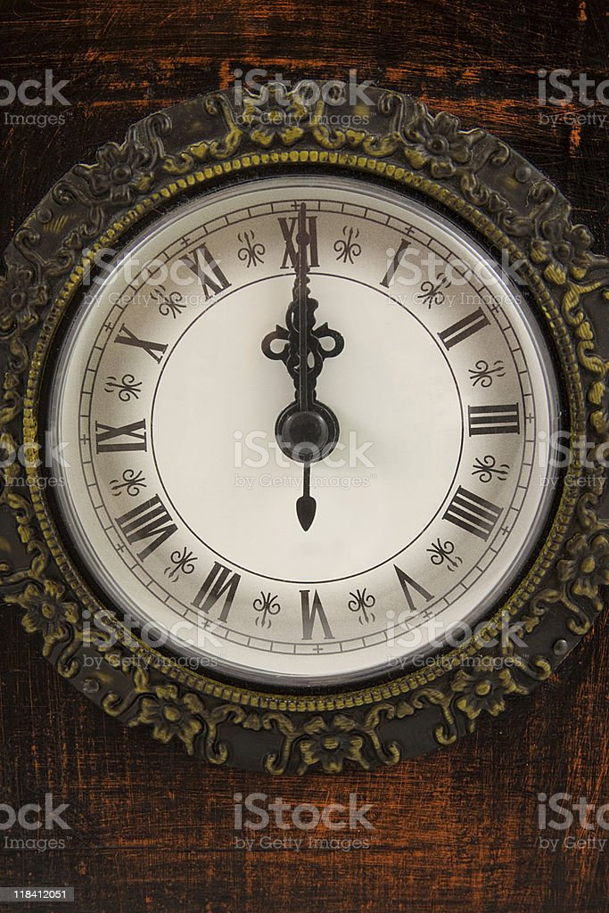 Clock strikes twelve o'clock stock photo
