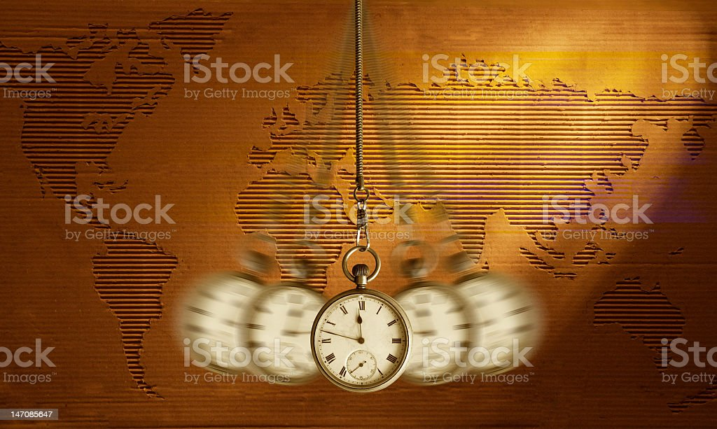 Clock swinging over an image of the world map royalty-free stock photo