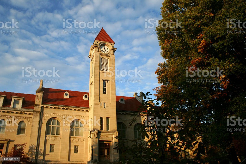 Clock tower against a slightly cloudy blue sky royalty-free stock photo
