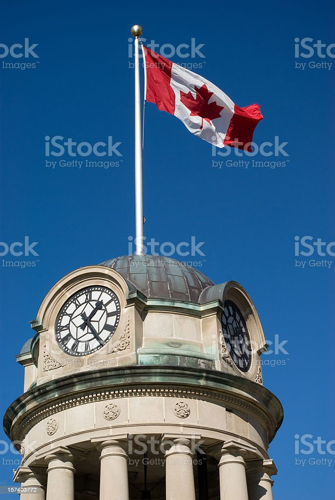 Clock Tower and Flag stock photo