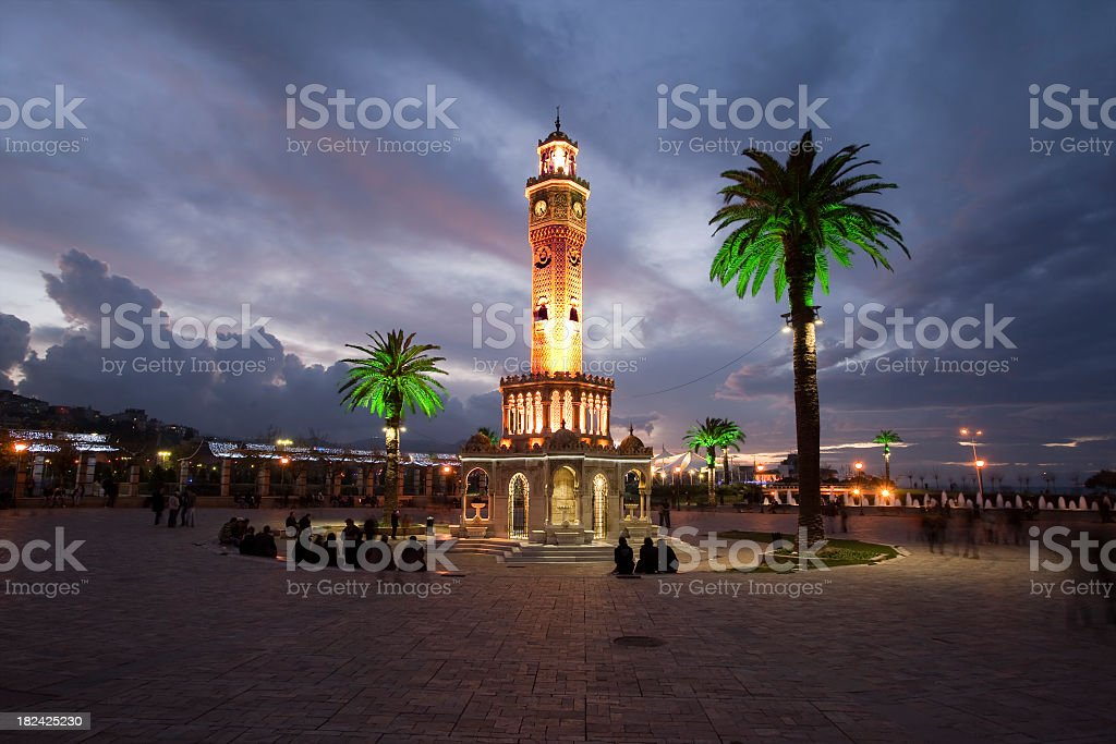 Clock tower and palm trees at night at Izmir stock photo