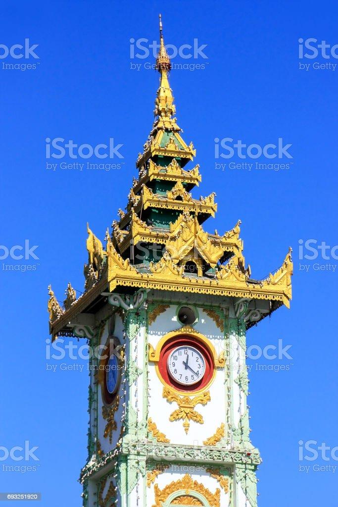 Clock tower at Mahamuni Pagoda complex in Mandalay, Myanmar stock photo