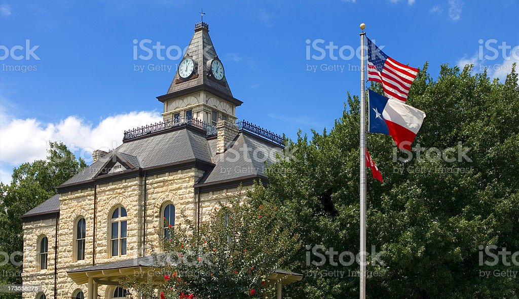 Clock tower, blue skies and trees in Texas, USA stock photo