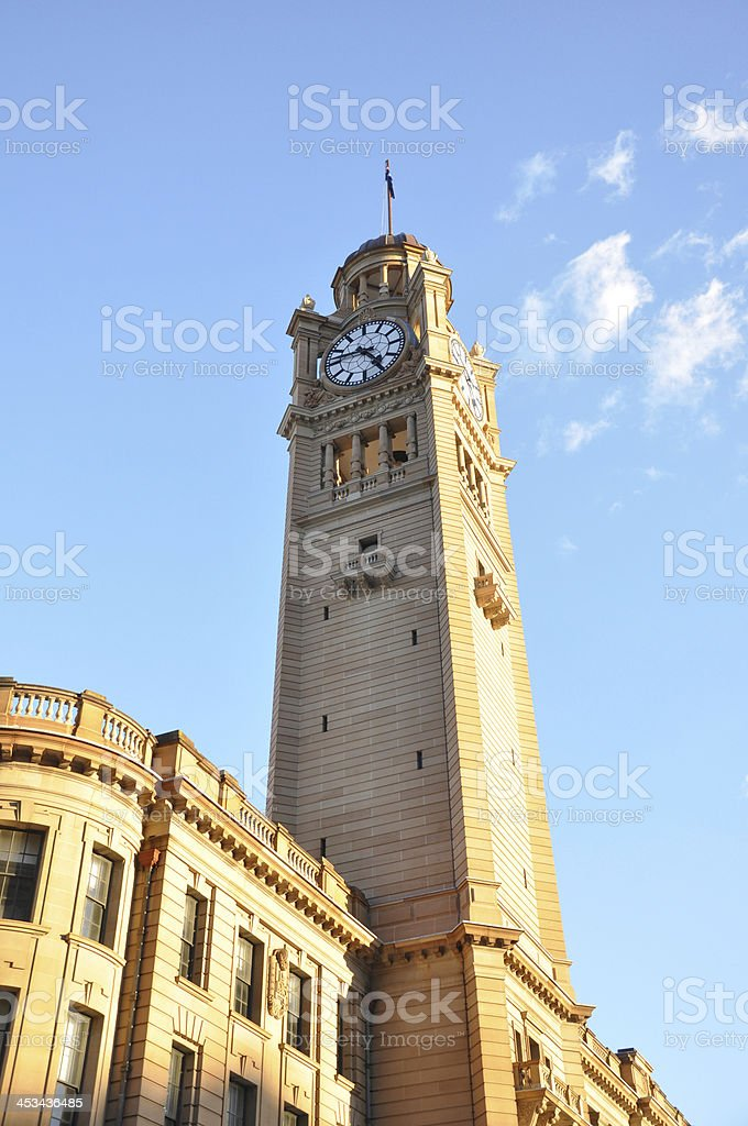 Clock tower building against blue sky background stock photo