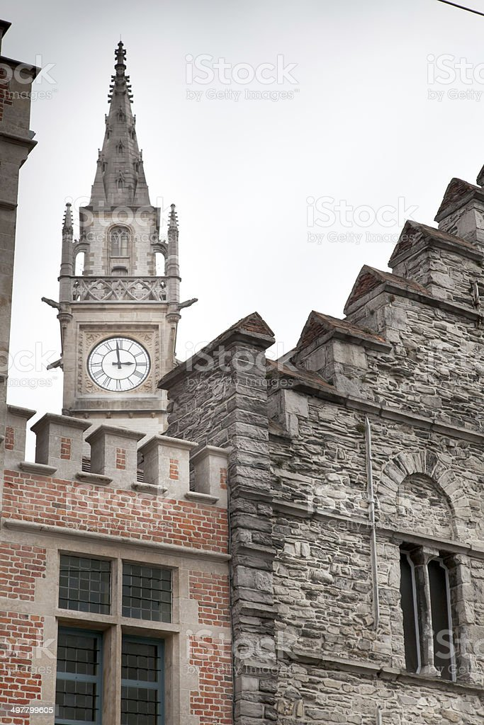 Clock tower in a city, Ghent, Belgium stock photo