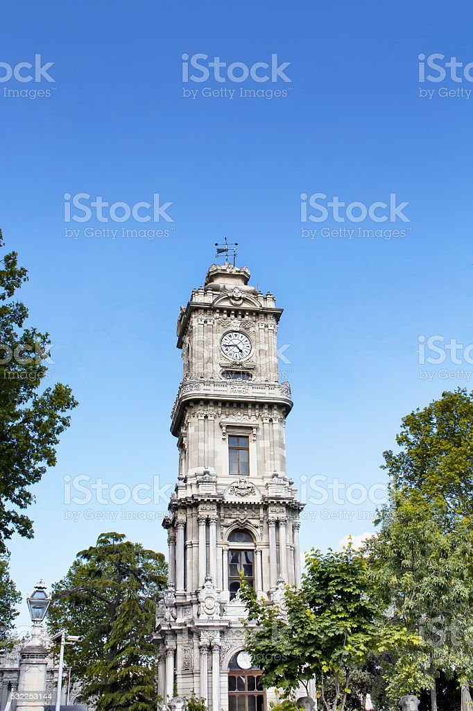 Clock tower of Dolmabahce Palace in Istanbul stock photo