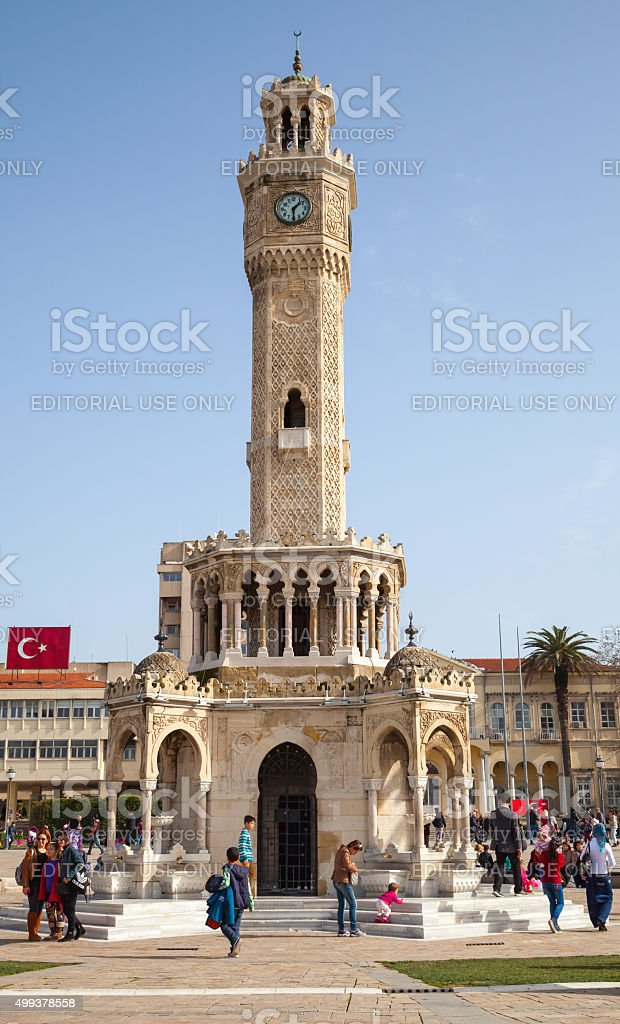 Clock tower of Izmir with ordinary walking people stock photo