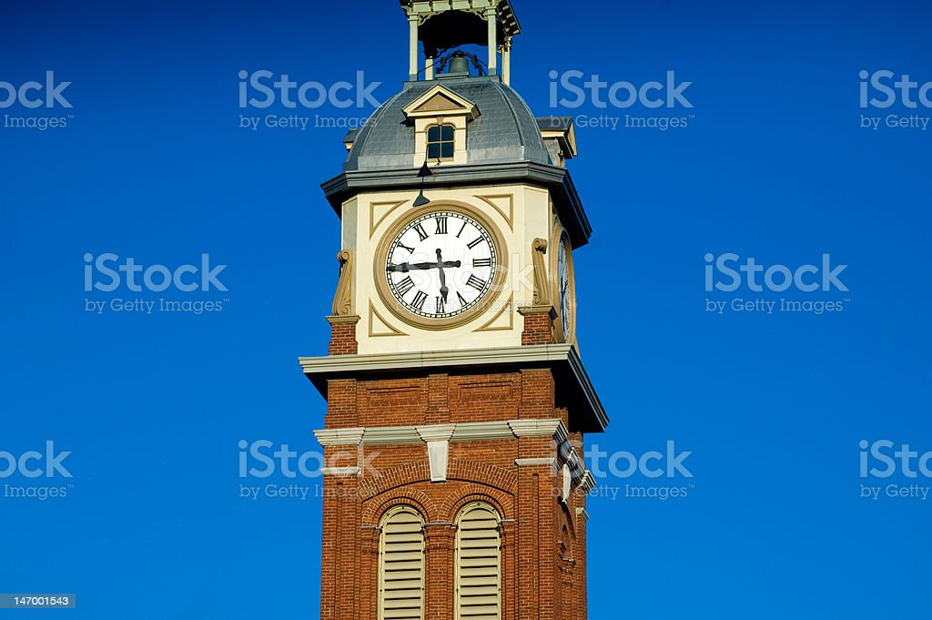 Clock Tower on a Blue Sky Background royalty-free stock photo