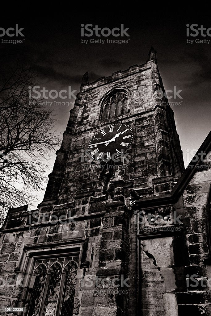 Clock Tower on Old Stone Church, Black and White royalty-free stock photo