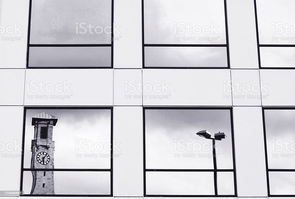 Clock tower reflected in glass windows - Civic Centre, Southampton stock photo