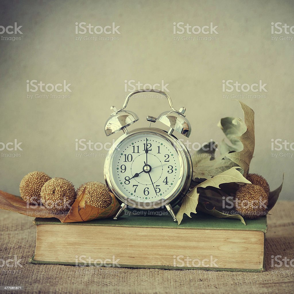 Clock with books royalty-free stock photo