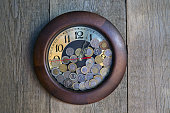 Clock with coins