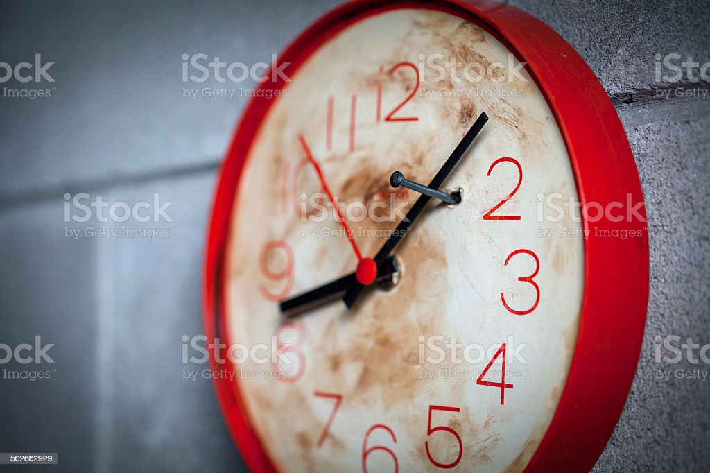 Clock with hands locked by a nail stock photo