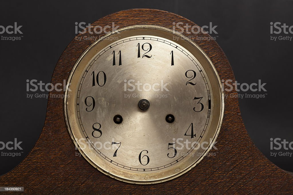 Clock with no hands on black background stock photo