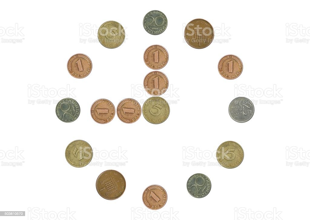 clock with old coins stock photo