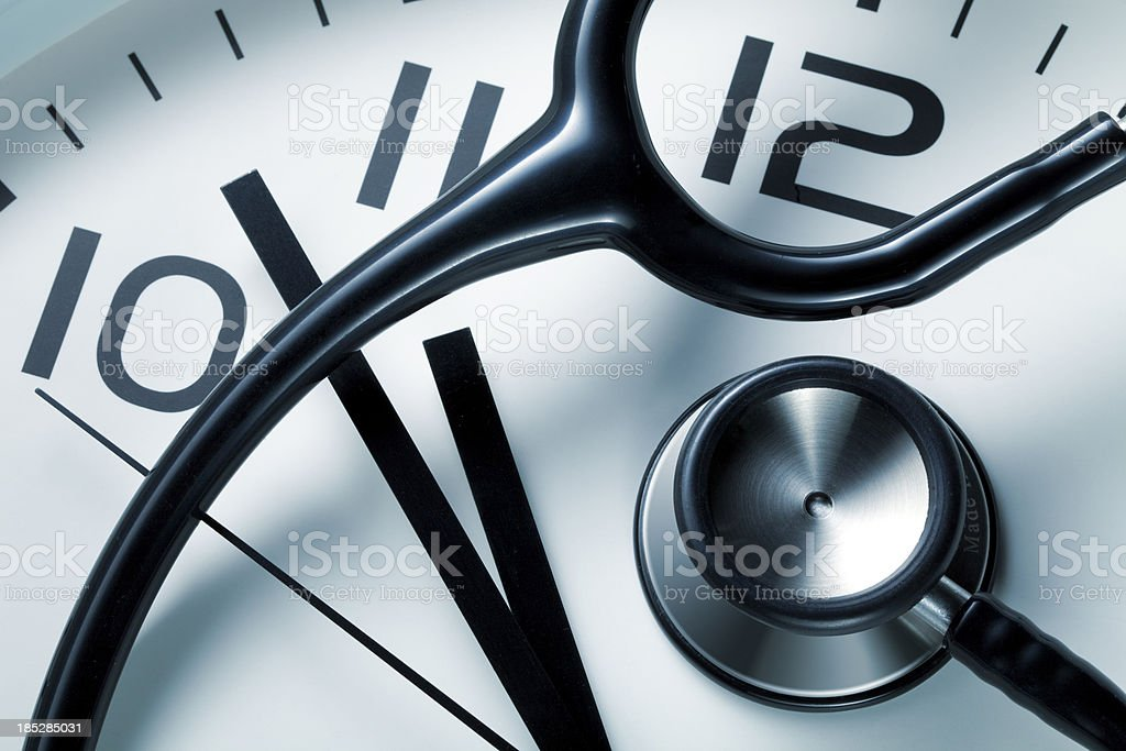 Clock with stethoscope stock photo