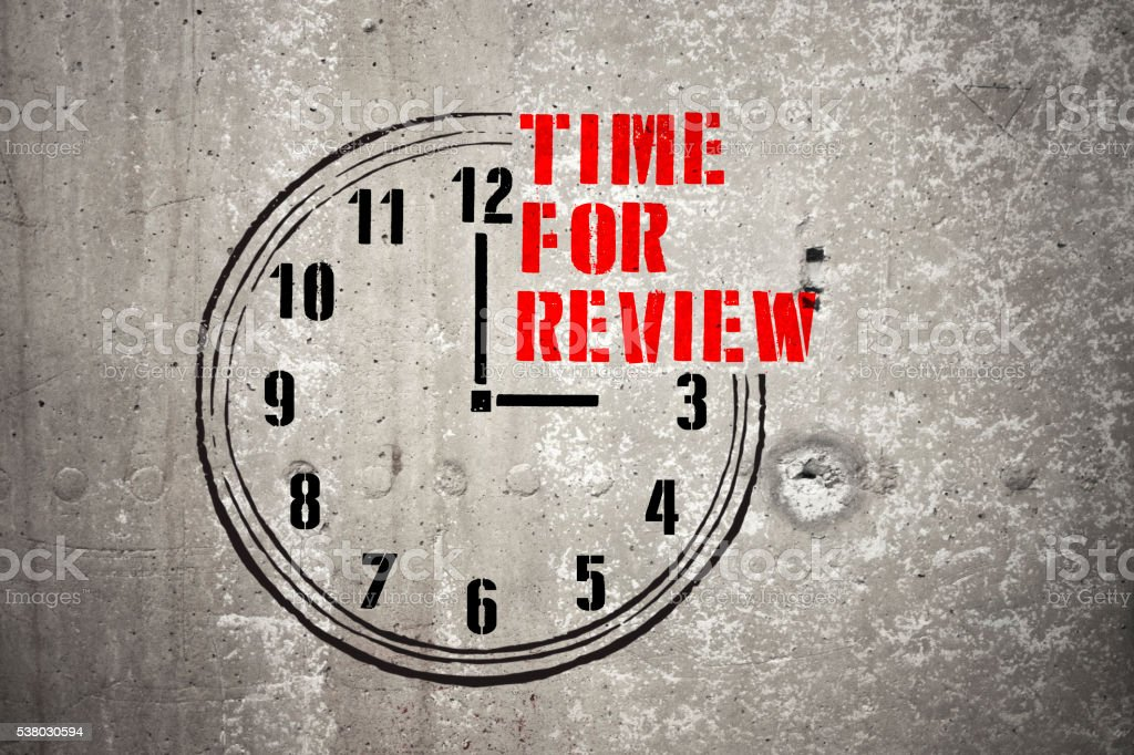 Clock with words TIME FOR REVIEW stock photo