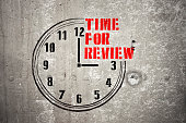 Clock with words TIME FOR REVIEW