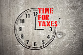 Clock with words TIME FOR TAXES