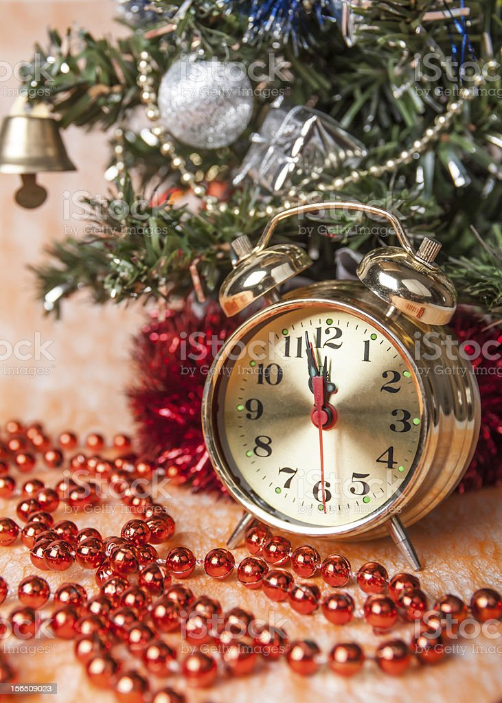 clock,Christmas beads on the background  trees royalty-free stock photo