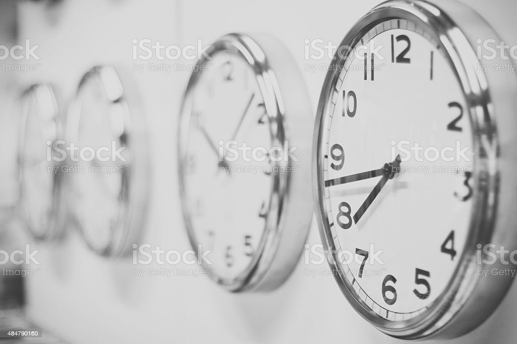 Clocks hanging on the white wall stock photo
