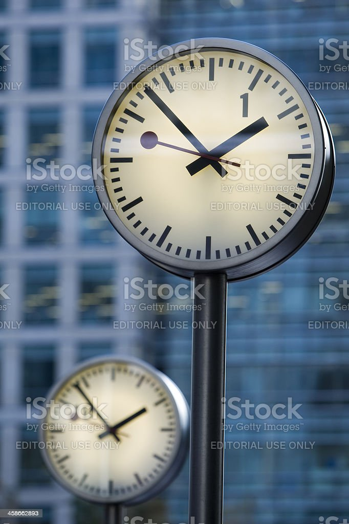 Clocks in Front of Business Tower, Canary Wharf, London stock photo