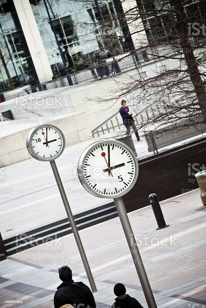 Clocks on One Canada Square in London stock photo