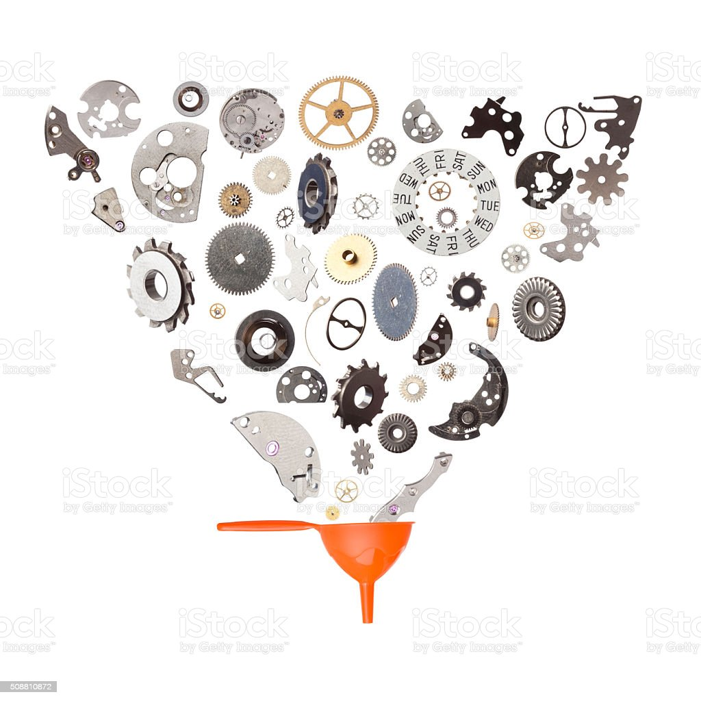 Clockwork Gears And Parts Flying Falling Into A Funnel stock photo