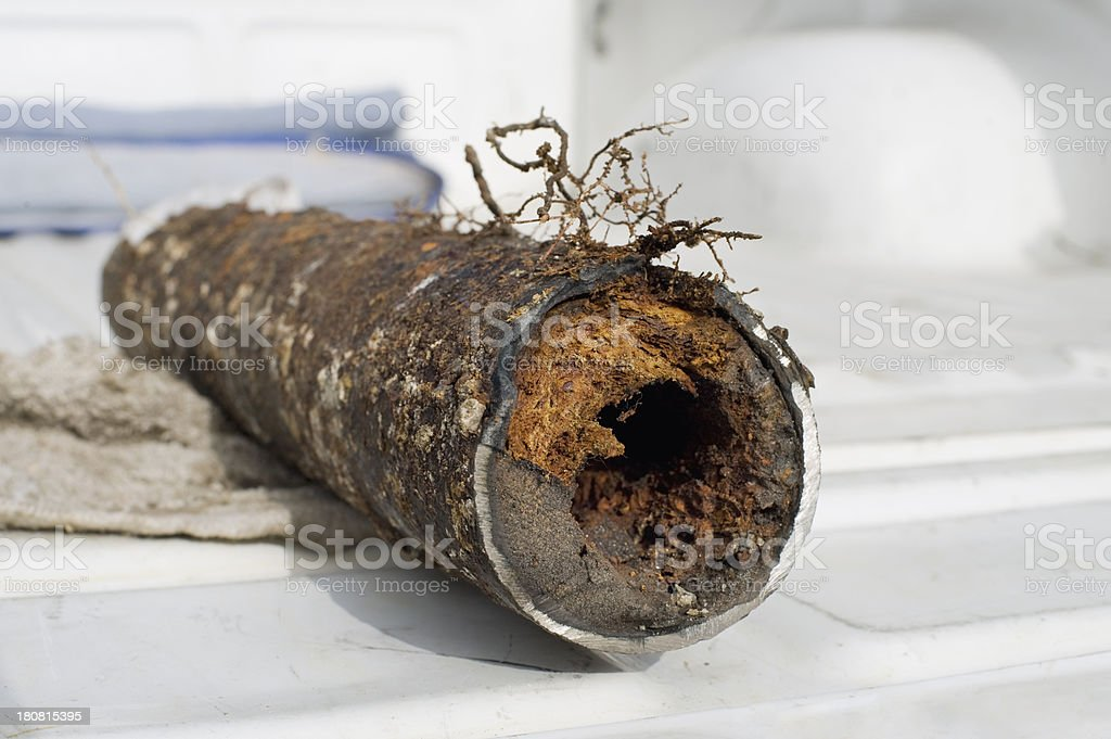 clogged drain pipe stock photo