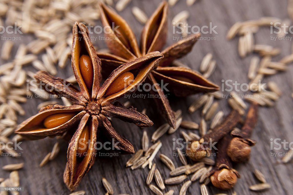 Close close-up anise on wooden surface stock photo