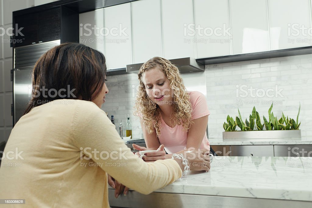 Close Friends Having Difficult Discussion in Kitchen royalty-free stock photo