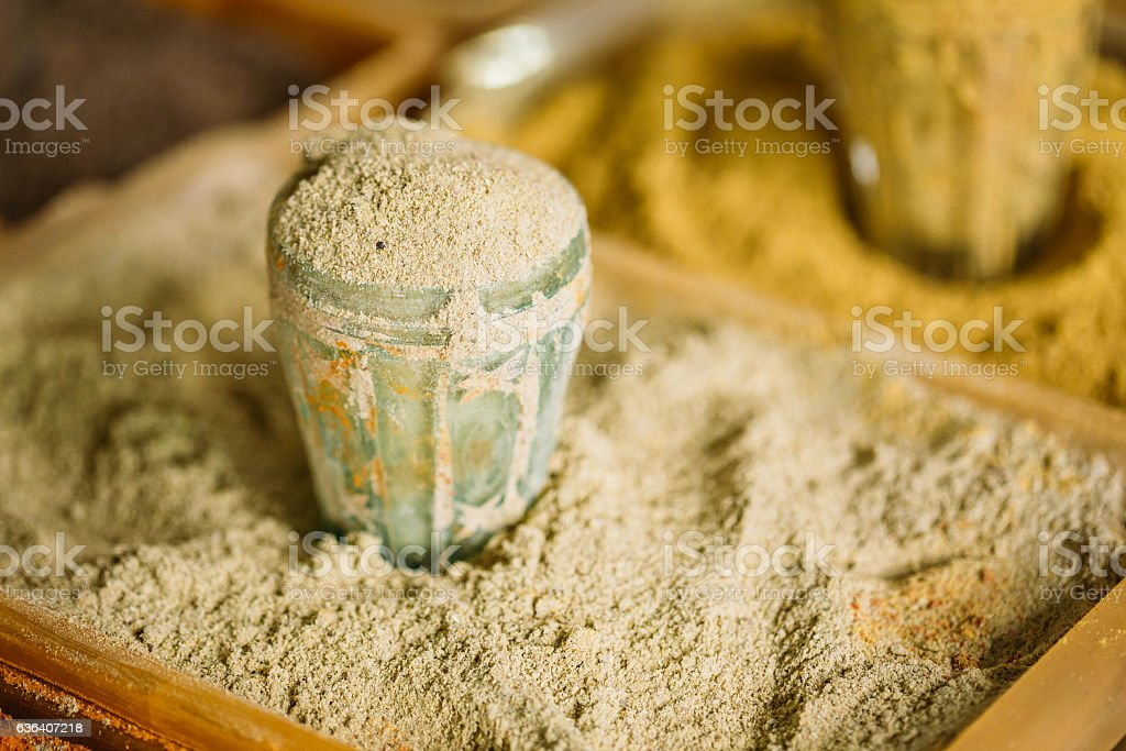Close Grated Nutmeg Fragrant Seasoning Condiment In Glass In Tray stock photo