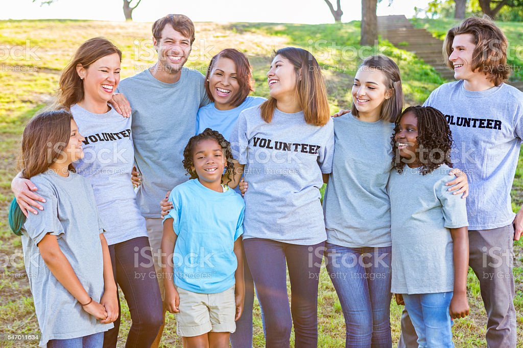 Close group of volunteers laughing together stock photo
