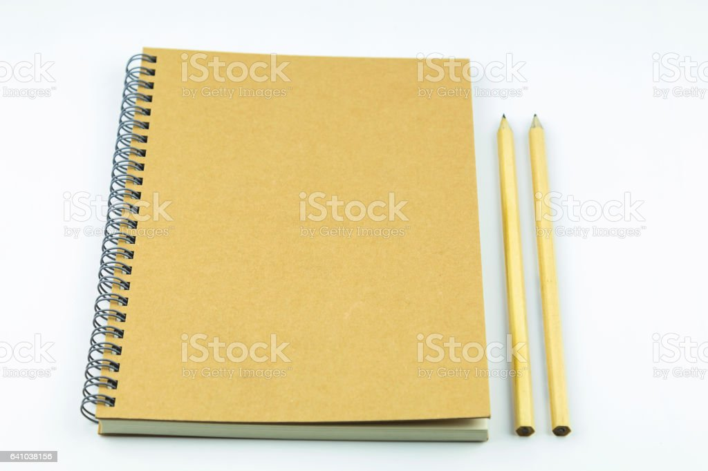 close notebook with pencil on white background stock photo