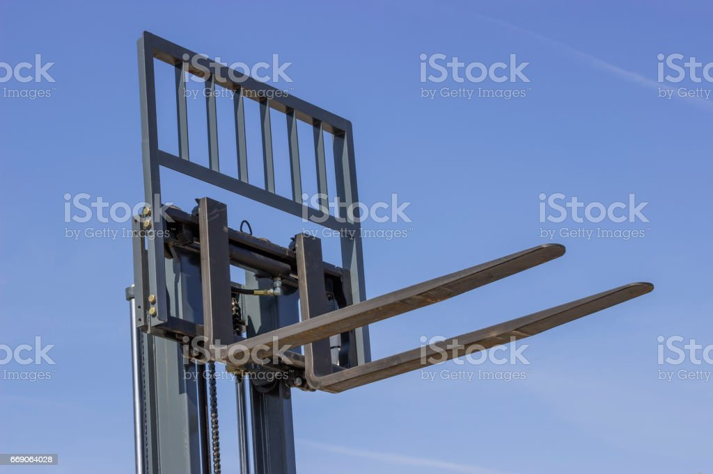 Close of adjustable pallet lifter stock photo