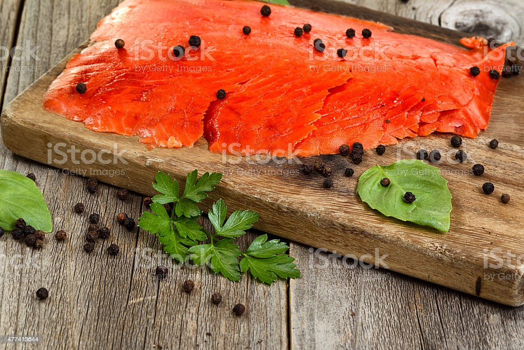 Close of cold smoked salmon on wooden server stock photo