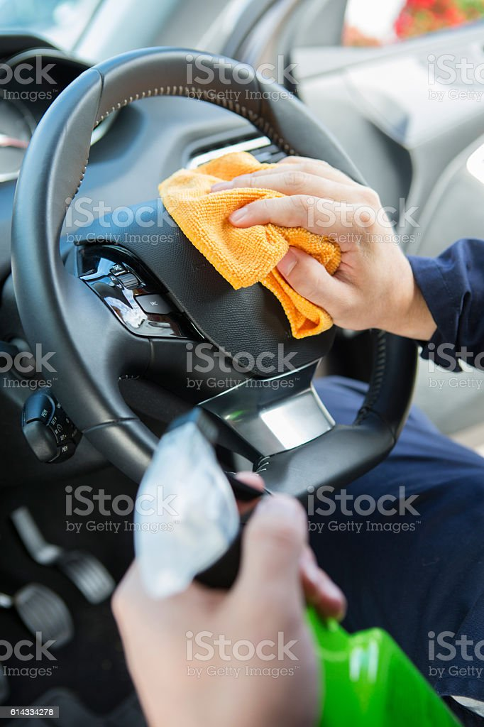 Close Of Man Cleaning Interior Of Car stock photo