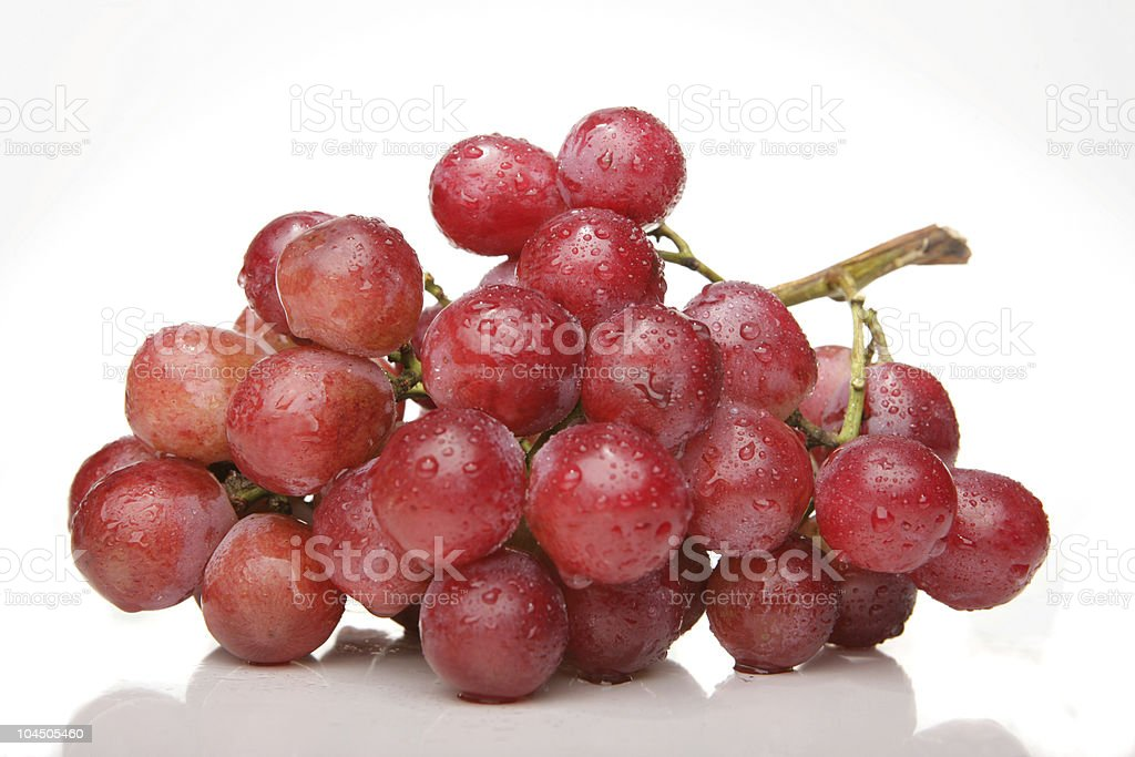 A close of up red grapes on a white background stock photo