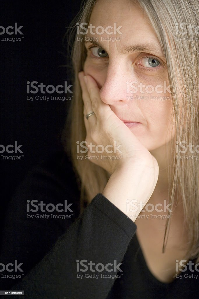 Close portrait and eye contact from a confident mature female stock photo