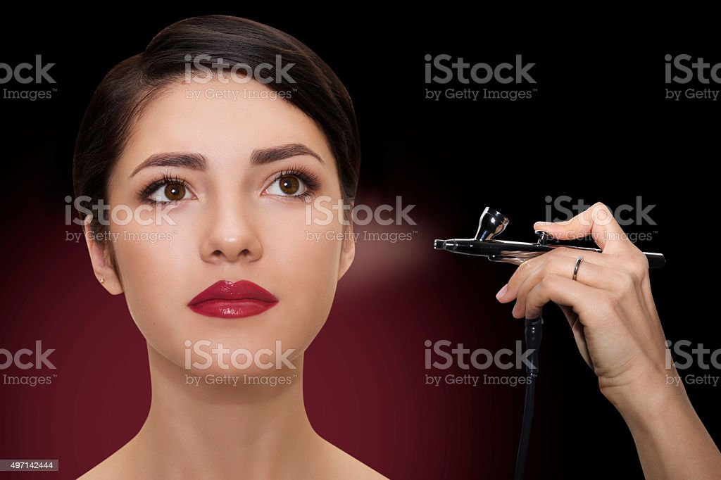 close portrait of a beautiful girl with make-up with airbrush. stock photo