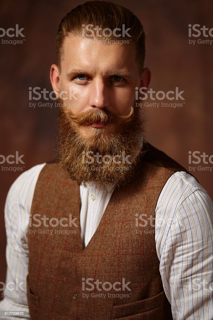 Close portrait of man with beard and mustache. stock photo